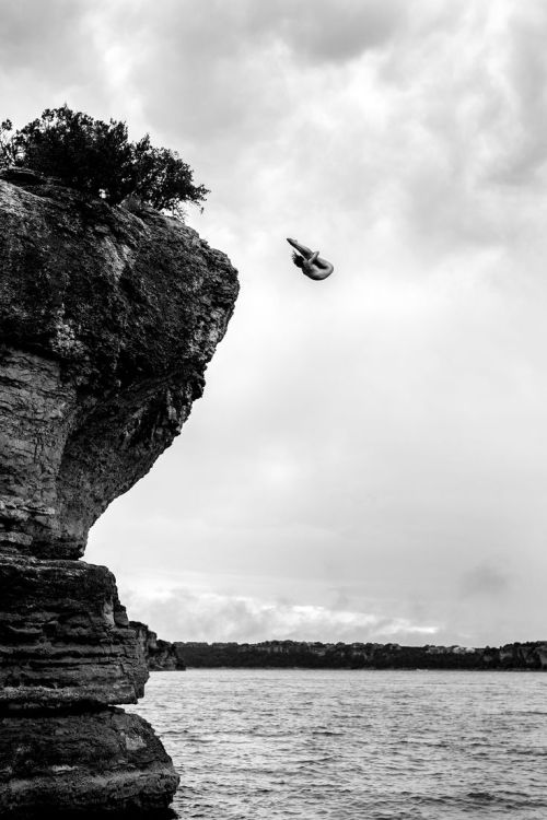 Ginger Huber of the USA dives from a 10 metre rock at Possum Kingdom Lake after the second stop of the Red Bull Cliff Diving World Series, Texas, USA on June 8th 2014.